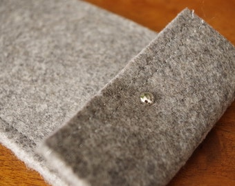 The mottled and silver in soft gray felt case