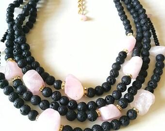 Big bold and beautiful, unique volcanic lava necklace with rough rozen quartz beads.