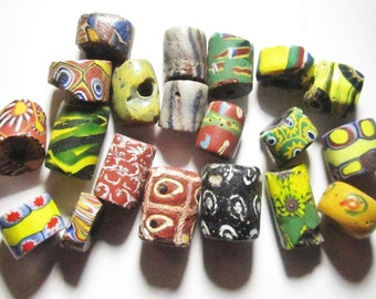 20 Mixed Antique African Trade Beads includes Eighteen 19th C Venetian Glass Millifiori Beads and 2 Glass Sand Beads