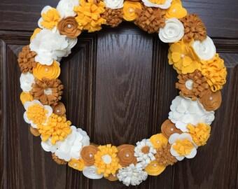 Felt wreath in yellow and cream