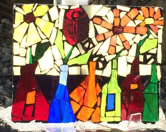 Mosaic Flowers in Bottles on glass