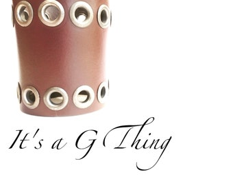 Wide Dark Brown Leather Cuff with decorative grommets