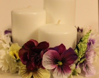 white and purple floral centerpiece