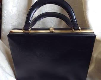 Vintage black vinyl rigid boxy handbag with 2 handles and bright red lining