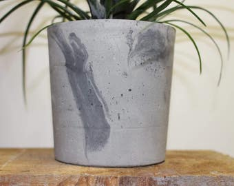 Light Grey Concrete Planter with random charcoal patterns.