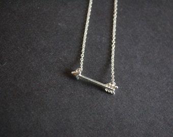 silver tone cupid arrow necklace
