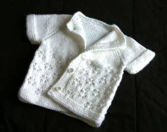 Handmade knit white newborn baby vest