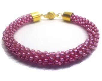 Pretty rose pink   bracelet beaded on a Kumihimo braid