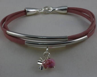 Multi-strand Leather bracelet with silver tubes and four leaf clover charm.