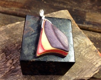 Recycled skateboard wood pendant.