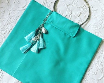 Mini charms a turquoise tote bag