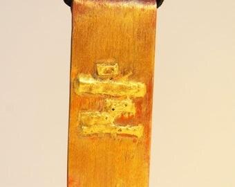 Copper and brass pendant
