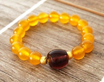 Yellow Jade Stretch Bracelet with Glass Accent Bead