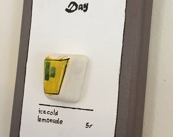 Wall decorated hanging , painted  plaster cast on canvas, drink of the day: icecold lemonade