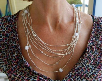 Multi-strand necklace in transparent pearls, bohemian crystal, silver beads and white pompons