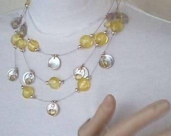 3 piece set yellow glass w/ shell discs & metal rings
