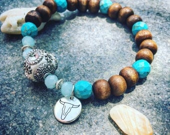 Bracelet blue/brown with charm and Bohemian bead