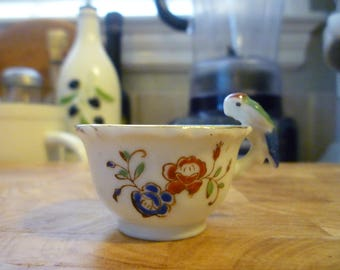 "vintage Japanese tiny teacup with a ""bird handle"""