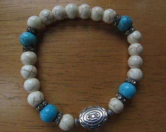 Mantra Bracelet with Turquoise Beads and Tibetion Sun Charm
