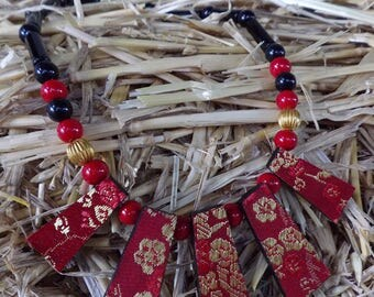 Gold and Red brocade fabric pendant necklace by Andrew Paget
