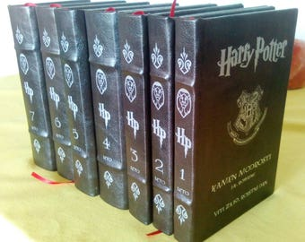 Harry Potter books in leather (or artificial leather) hardcover.
