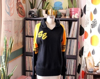 vintage cheerleader sweater . yellow & black sweater with raglan sleeves . 1990's uniform sweater 92
