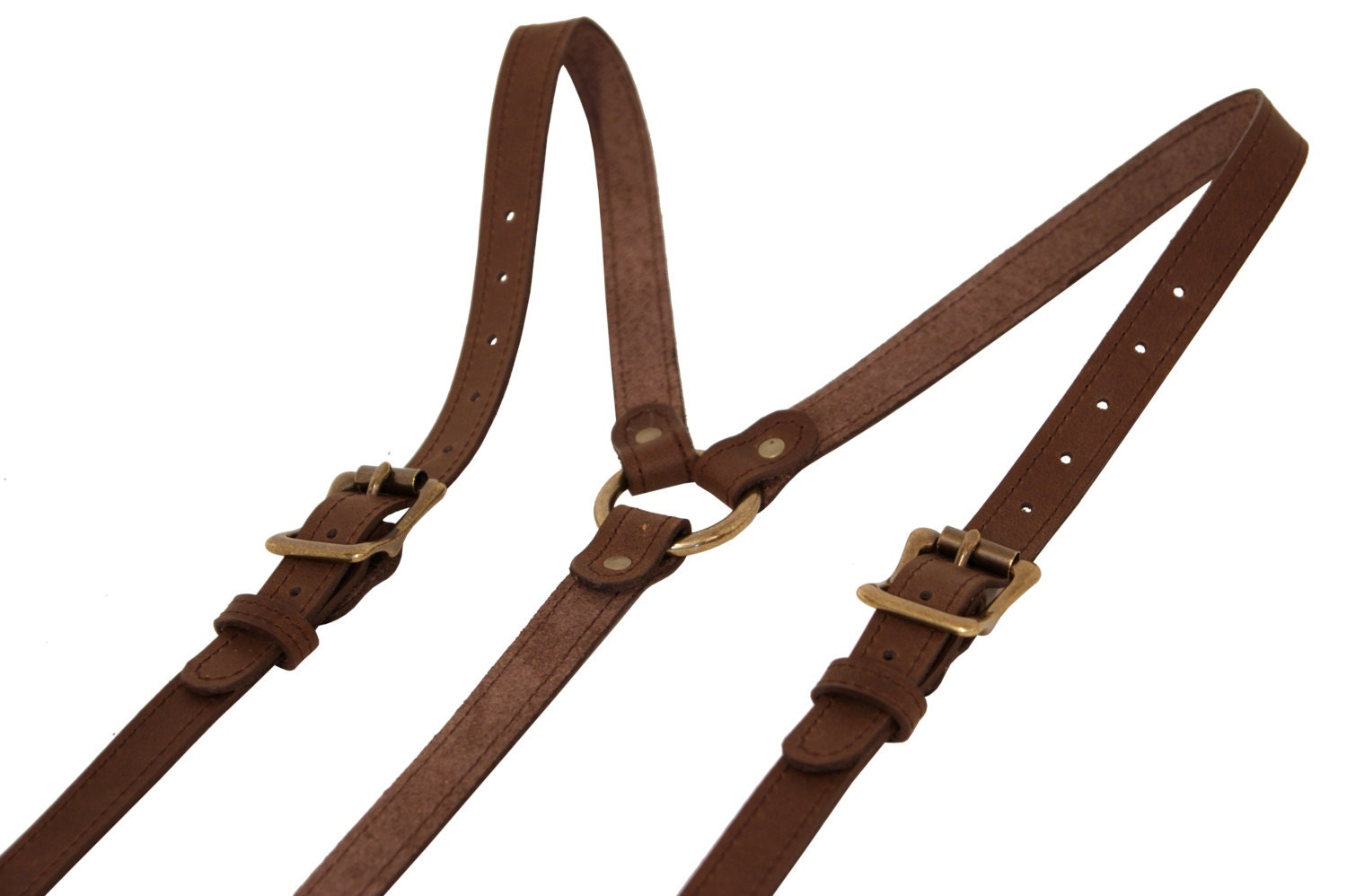 Adherents to 19th century gentlemen's fashion will appreciate our fine Leather Buckle Suspenders in black. Long before the introduction of the belt, the proper way to hold up trousers was with a pair of these over-the-shoulder contraptions that attached via buttons on the waistband.