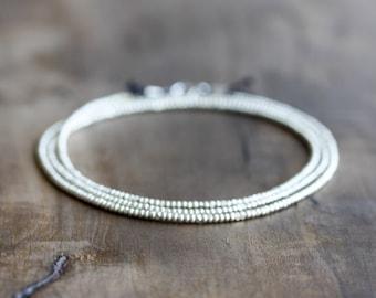 Silver wrap bracelet - silver seed beads, black silk, sterling silver clasp - stacking, layering bracelet or necklace - beaded wrap bracelet