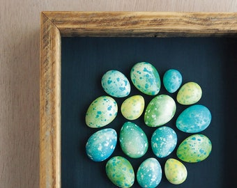 Green and blue speckled plaster egg framed wall art: handmade in Australia by Kuberstore