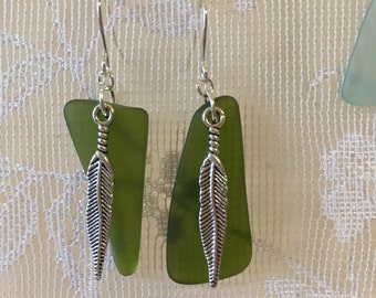 Lovely Green sea glass dangle earrings embellished with feathers beach glass inspired jewelry