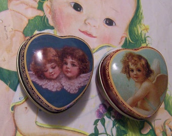 two tiny angel pill box tins