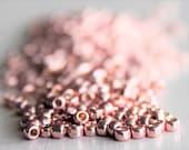 20g Galvanized Sweet Blush Size 8 TOHO Seed Beads