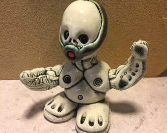 Ceramic Sculpture , gas mask, he man, action figure, kung fu
