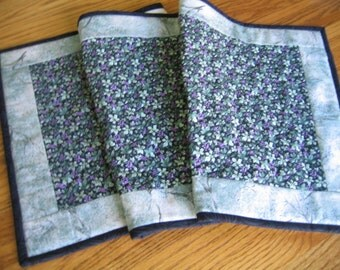 Last One - Quilted Table Runner in a Leaves and Small Purple Grapes on Black Pattern