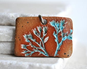 Pretty Nature Pendant, Ceramic, impressed with a real Wisconsin plant, turquoise glaze, brown stoneware clay, blue green on tan, terra cotta