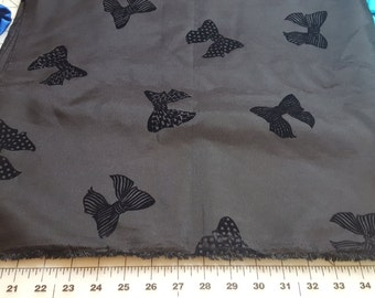 black poly Tafetta with allover flocking Bows Just over 1yd