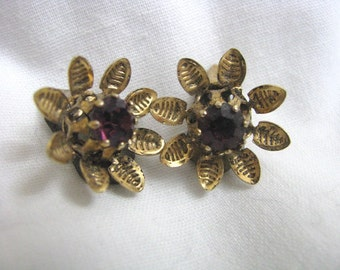 Vintage antiqued gold tone clip on clip back earrings with purple center