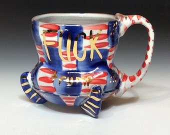 Large footed fuck trump on the left side mug with dots of gold luster