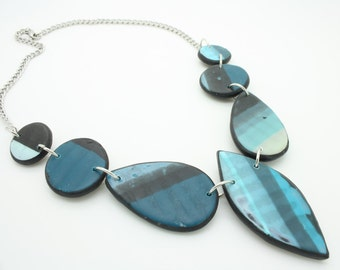Shades of blue plus black and white handmade one of a kind polymer clay bib necklace, chunky necklace
