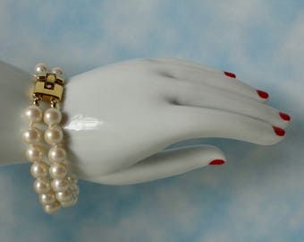 MONET 2 Strands Knotted Faux Pearl with Gold tone Closure Bracelet.