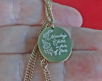 """AVON signed Vintage gold tone 17"""" necklace with 1"""" MONDAYS CHILD is Fair of Face pendant in great condition"""
