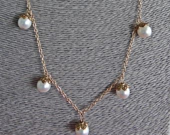 """Vintage goldtone 26"""" necklace with attached pearl accents in great condition"""