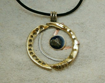 Brass pendant with meteorite piece