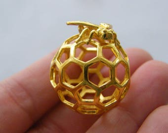 1 Bee and honeycomb charm gold tone GC72