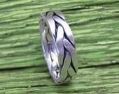 Braided and oxidized ring