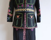 Moschino black wool knit suit with peace and flower embroidery