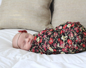 Baby girl swaddle blanket and headband set. Light weight red floral, with a matching red leather  bow