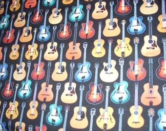 Guitars on Black -  Cotton Fabric - 15 inches wide and sold by the yard