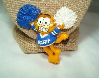 1981 GARFIELD the Cat Cheerleader with Blue and White Pom Poms Pin.