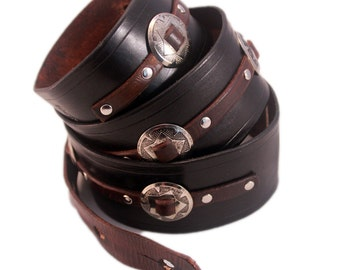 Black leather guitar strap with conchos